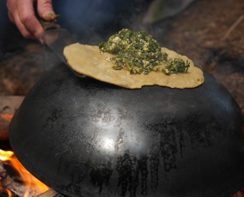 Cooking gözleme on a wok