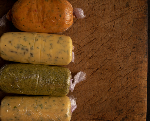 flavoured butters wrapped in clingfilm ready for the fridge